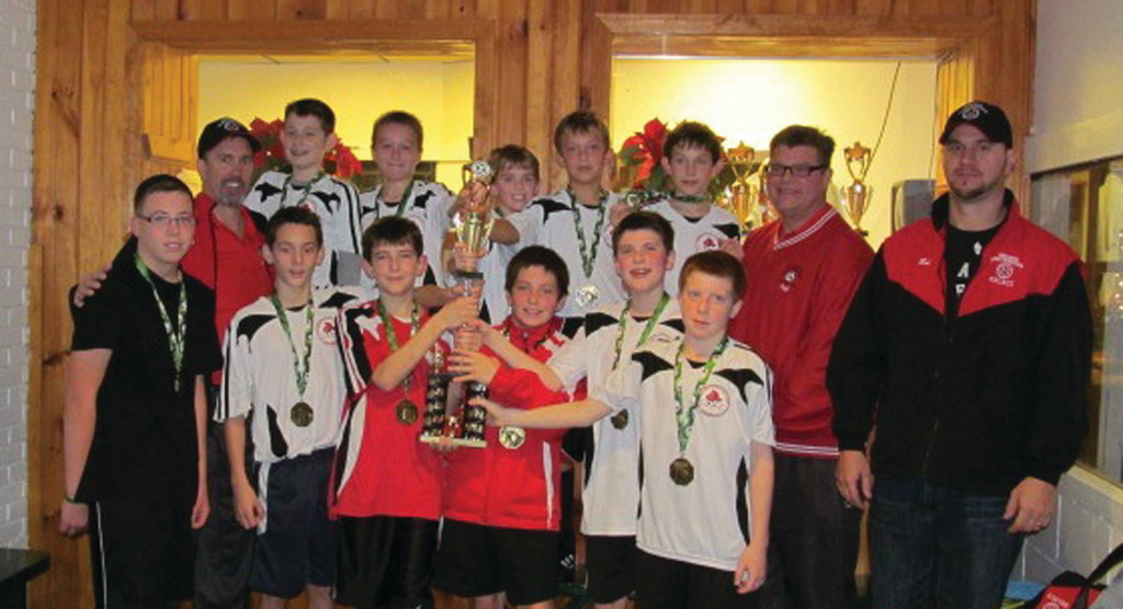 NUMBER ONE: The Warwick Fire Fighters U12 Boys team, which calls itself the Rabid Squirrels, won the indoor championship at Sherwood Ultra Sports. Pictured, front row: Ed Pereira, Dawson Enright, Henri Snyder, Nick Franklin, Kyle Buchanan, coach Jeff Lockhart, coach Ed Pereira. Back row: coach Bill Cocroft,  Zach Miller, Luke Lockhart, Justin Renehan, Luke Zelano, Brody Cocroft.