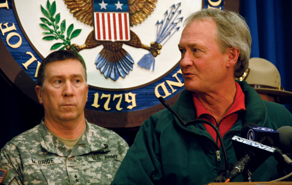 INFORMING THE PUBLIC: General Kevin McBride stands with Governor Lincoln Chafee during a press conference Saturday night.