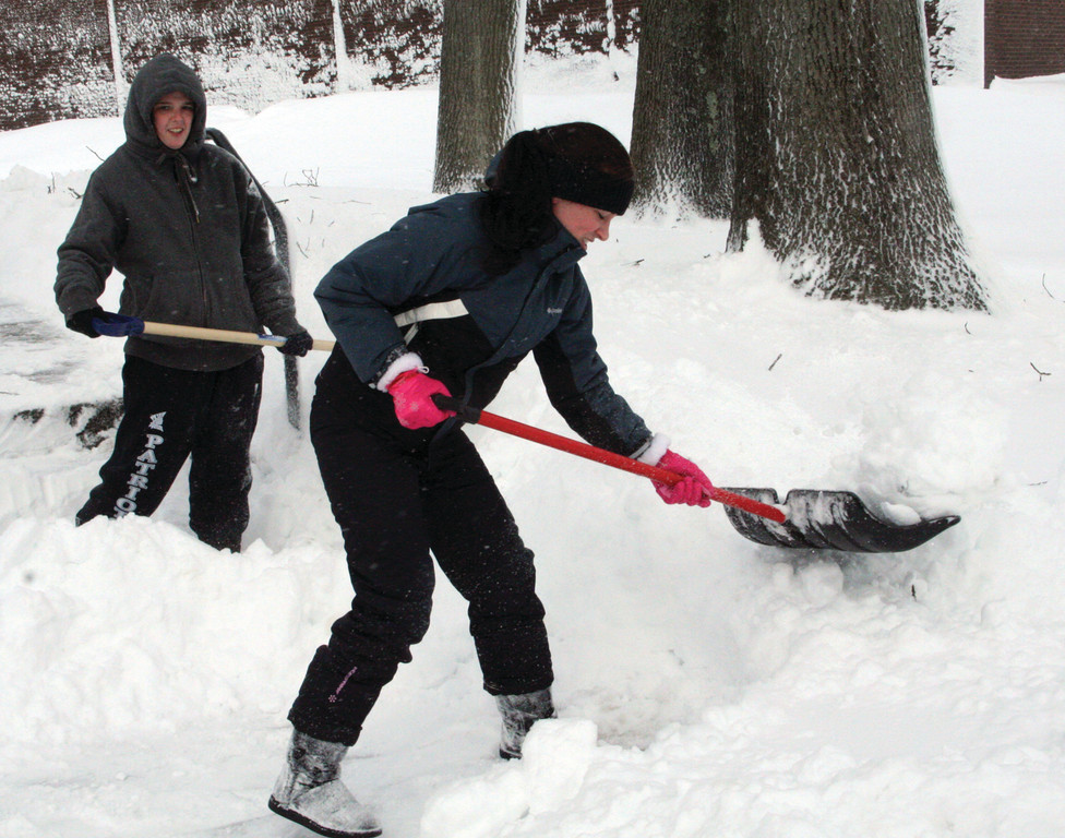 HELPING HANDS: Jenn Germani (right) and Erin Fennessy shovel at that Rhode Island Family Shelter.