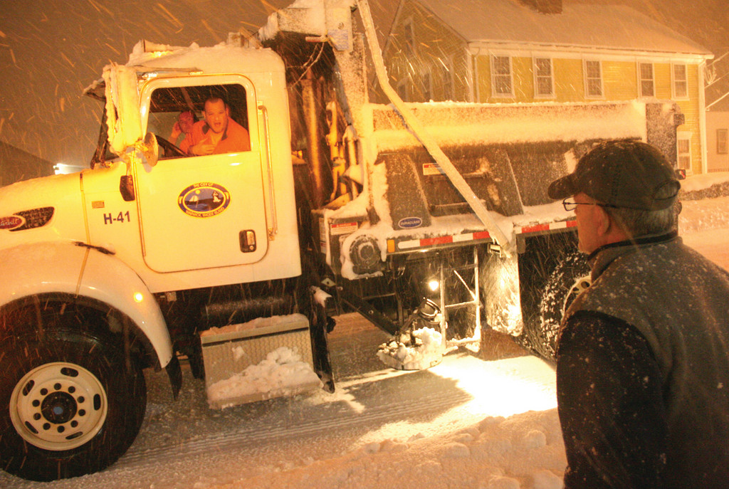 ASSESSING CONDITIONS: Picozzi chats with a plow driver.