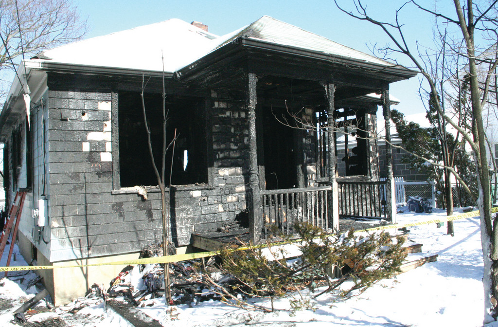 UP IN FLAMES: The cottage on Arnold's Neck Drive that burned Friday night. Luckily, no one was harmed.