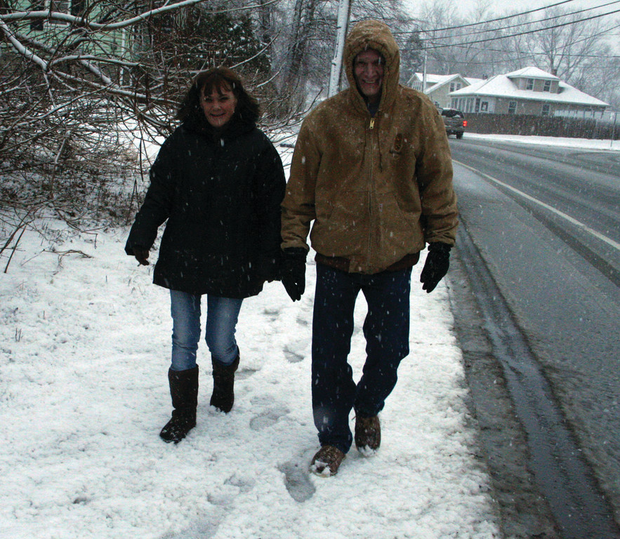 WINTER WALK: Lyn and Gary Dalton venture out to experience the storm.