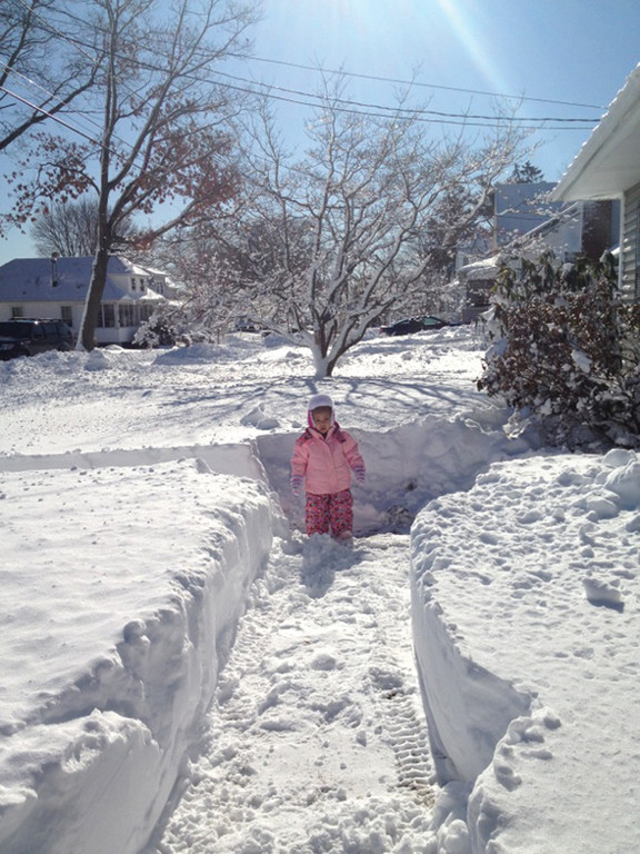 OVERWHELMED: Ela Edouard takes in the snowdrifts that are as tall as she is.