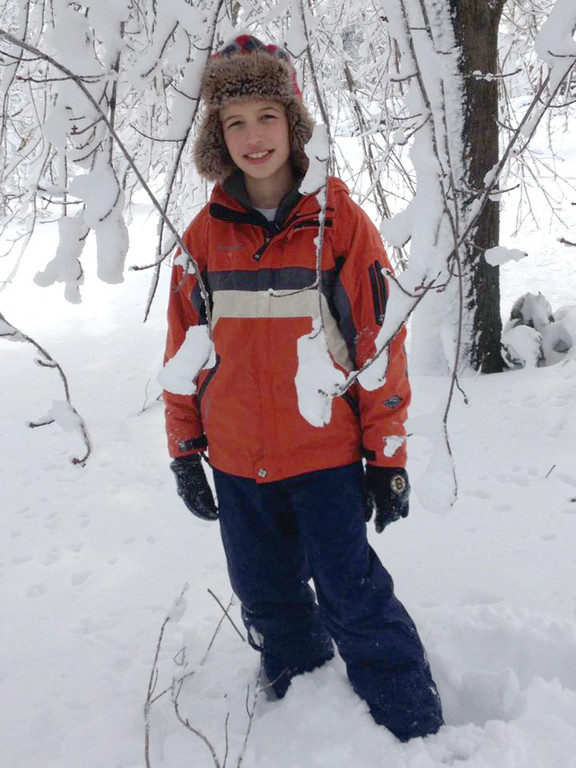 TAKING IT IN: Cade Petrella checks out the Garden City neighborhood after snowfall stopped.