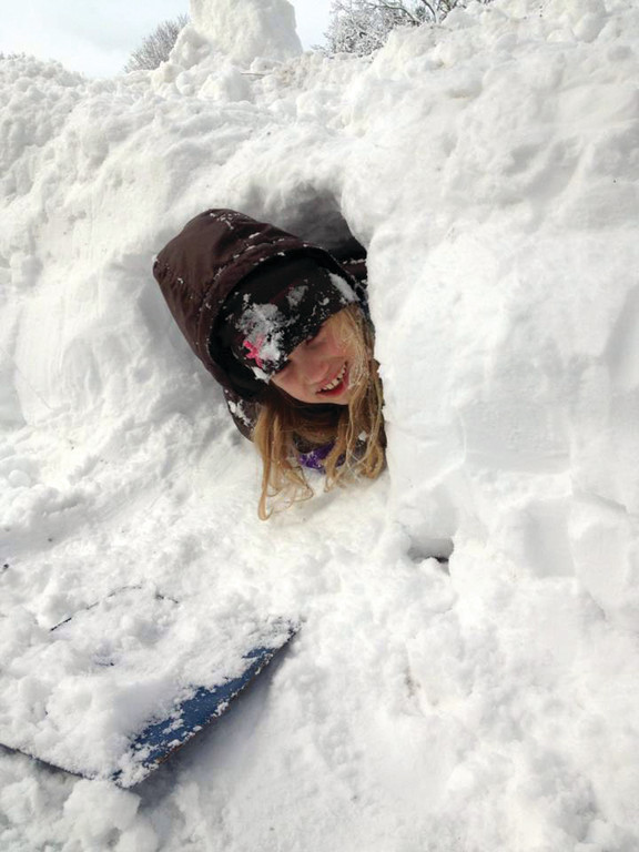 COME AND FIND ME: Gabrielle Petrella digs her way into a snowdrift.