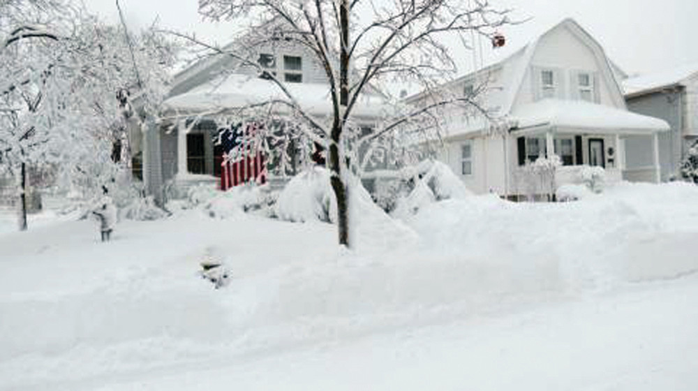 WAVING PROUDLY: This American flag stands out in the whitewashed Pontiac neighborhood.