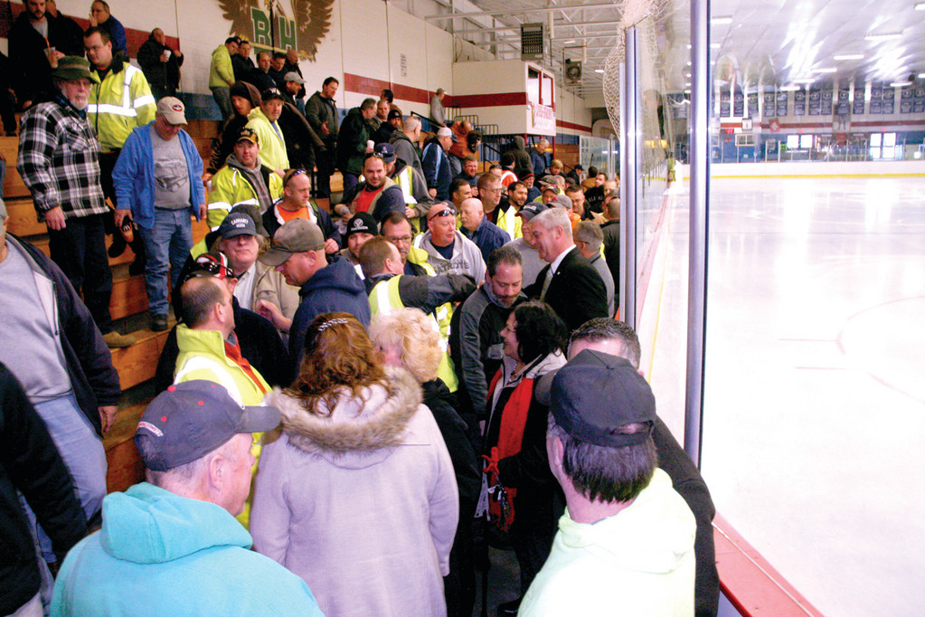 SAYING THANKS: Mayor Scott Avedisian was accompanied by other city officials and DPW acting director David Picozzi and Fire Chief Edmund Armstrong praised city workers for their efforts during the blizzard early yesterday morning at Thayer Arena.