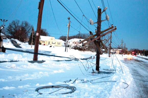STORM TANGLE: This is just one of the many downed wire conditions National Grid crews faced.
