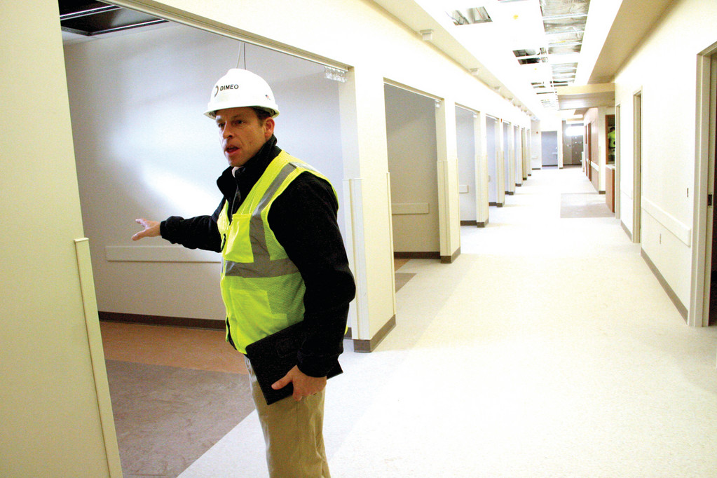 PLENTY OF ROOMS: Project manager James Bendokas in the corridor of pre-operation rooms.