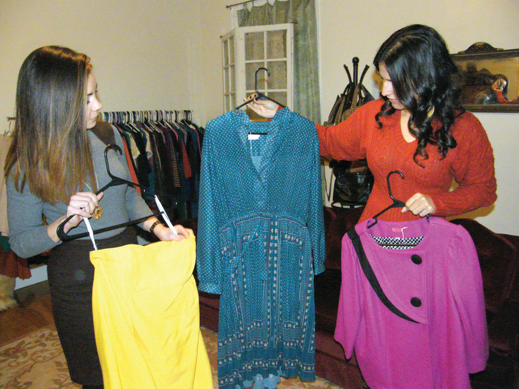 Rebecca Hancock (left) and Jay Davani started Suede, a business that buys thrifted goods for cheap and resells them at a bargain price. It takes the work out of hunting for bargain deals, while still providing people with stylish clothes for less.