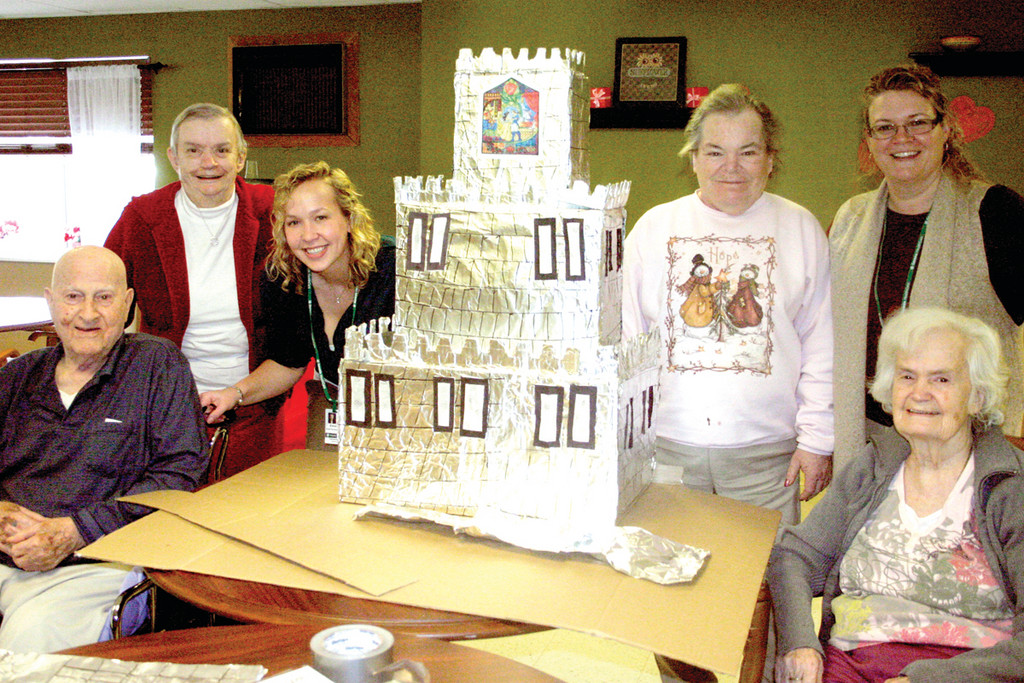 "CREATIVE CASTLE: Team ""Leaps for Love"" created a fairytale theme, complete with castle. They used cardboard boxes to create the frame, lined the outside of it with aluminum foil and drew some squares on the foil with black markers to make it appear like stone."