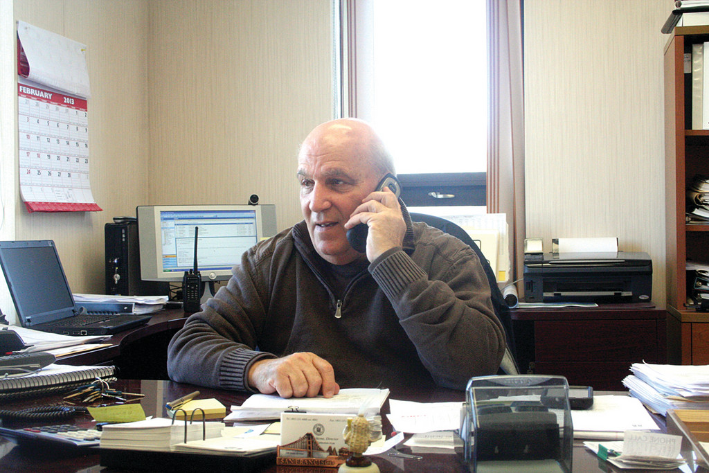 Director of Public Works Arnie Vecchione fields calls from residents and plow drivers yesterday, as cleanup efforts continued.