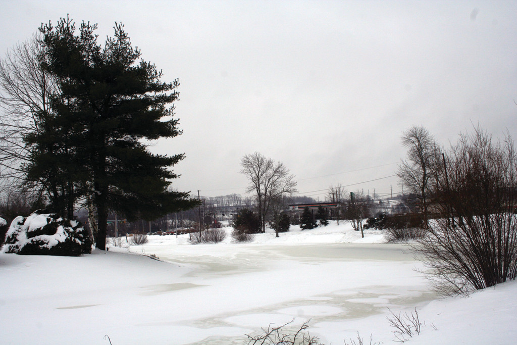 Memorial Park is blanketed with snow, before rain started coming down Monday.