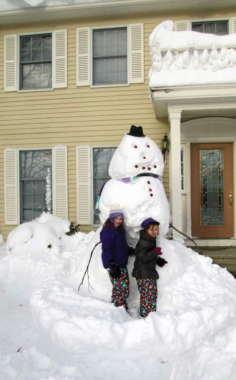 Eight-year-old Peyton and 6-year-old Remington Czerwein of Johnston helped to build a nine-foot-tall snowman at their house.