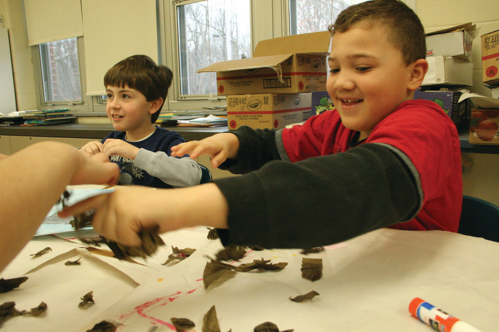 RIPPING RIGHT INTO A PROJECT: Second grader Jarek Haley needed no prompting to shred tissue paper for his collage.