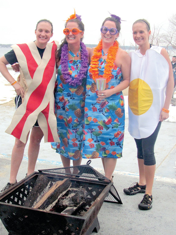 SUPER SPECIAL SISTERS: The Lictenauer twins, Lauren (left) and Kristen of Columbus, Ohio who were dressed as bacon and eggs, join friends Christina and Becky Henriques prior to Saturday's first ever Polar Dip. These sisters met back in 2009 while volunteering for Camp Sunshine.