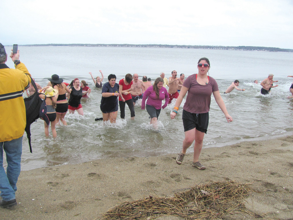 FREEZIN' FRIENDS: This is just a portion of the nearly 100 people who had a reason for freezin' Saturday and participated in the first ever Polar Dip that raised upward of $20,000 for Camp Sunshine in Casco, Maine.