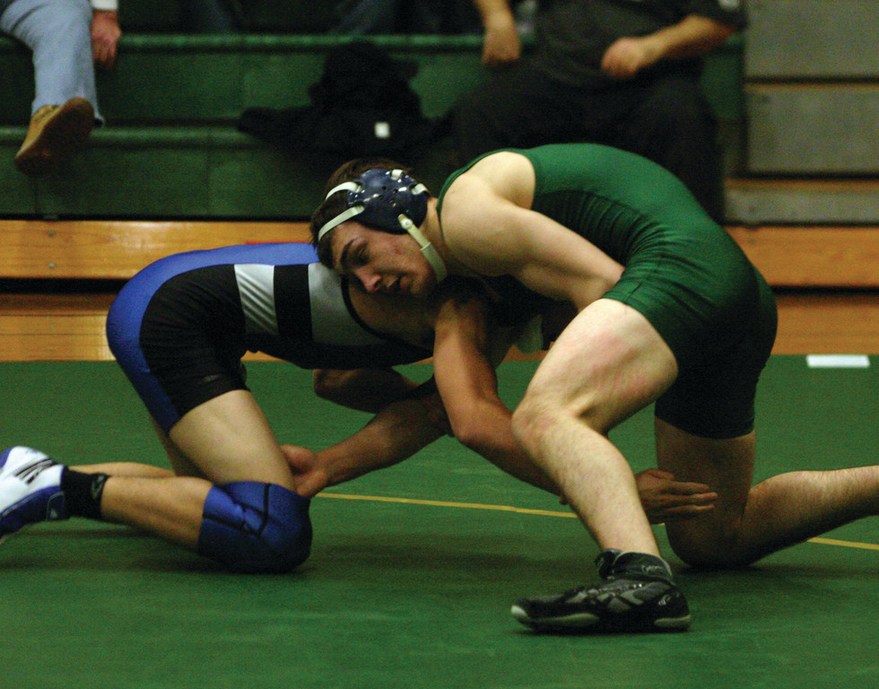 LOCKED UP: Chris Barone wrestles at 152 on Thursday, when the Hawks picked up their biggest win yet.