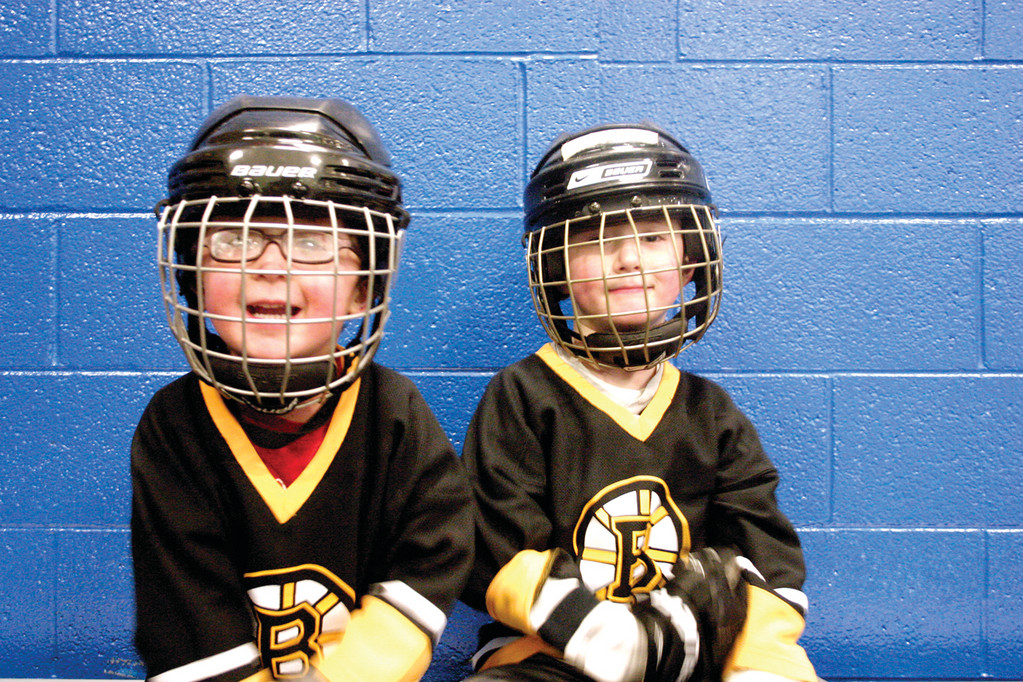 HOCKEY STARS: Camden King, 3, and his brother Colin, 5, show off their hockey gear at Thayer Arena's public skating hours yesterday afternoon.