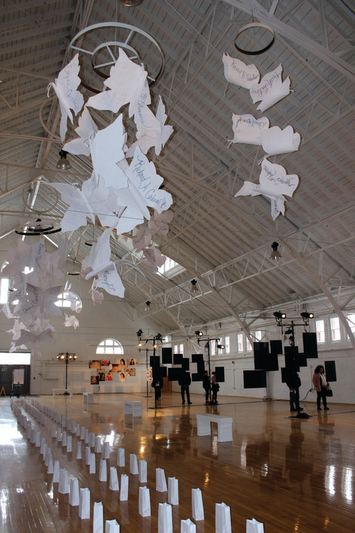 100 BUTTERFLIES: Large mobiles made up of felt butterflies dangled above the photographs. Each of the butterflies bore a name of the victim.