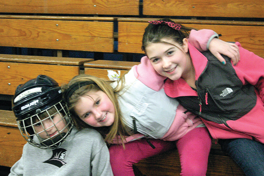 FUN ON THE ICE: Kyle Menard, Megan Menard and Sheridan Mattox enjoy their first day of February vacation at Thayer Arena's public skating hours yesterday.