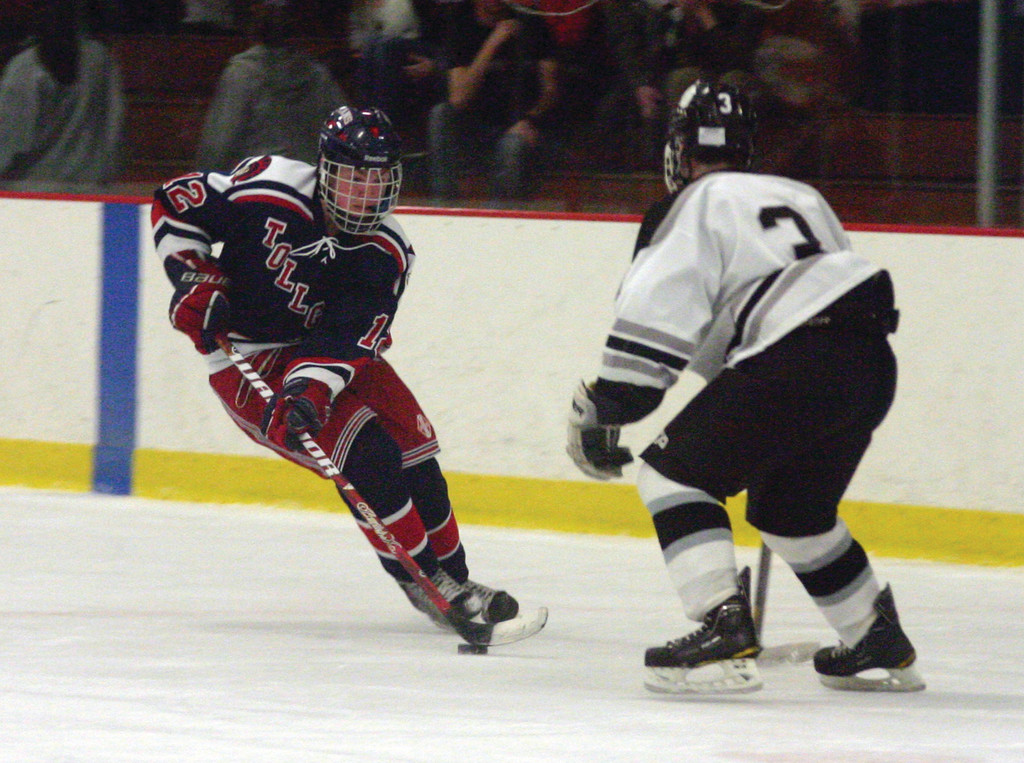 INTO THE ZONE: Toll Gate's John Sullivan carries the puck in front of Pilgrim's Cory Casale on Friday