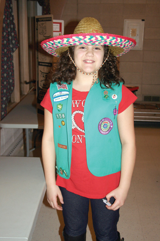 A MEXICAN HAT: Junior Jenna Testone, from the Brownie/Junior Troop 156, shows off her Mexican sombrero as part of her troop's presentation on Mexico.