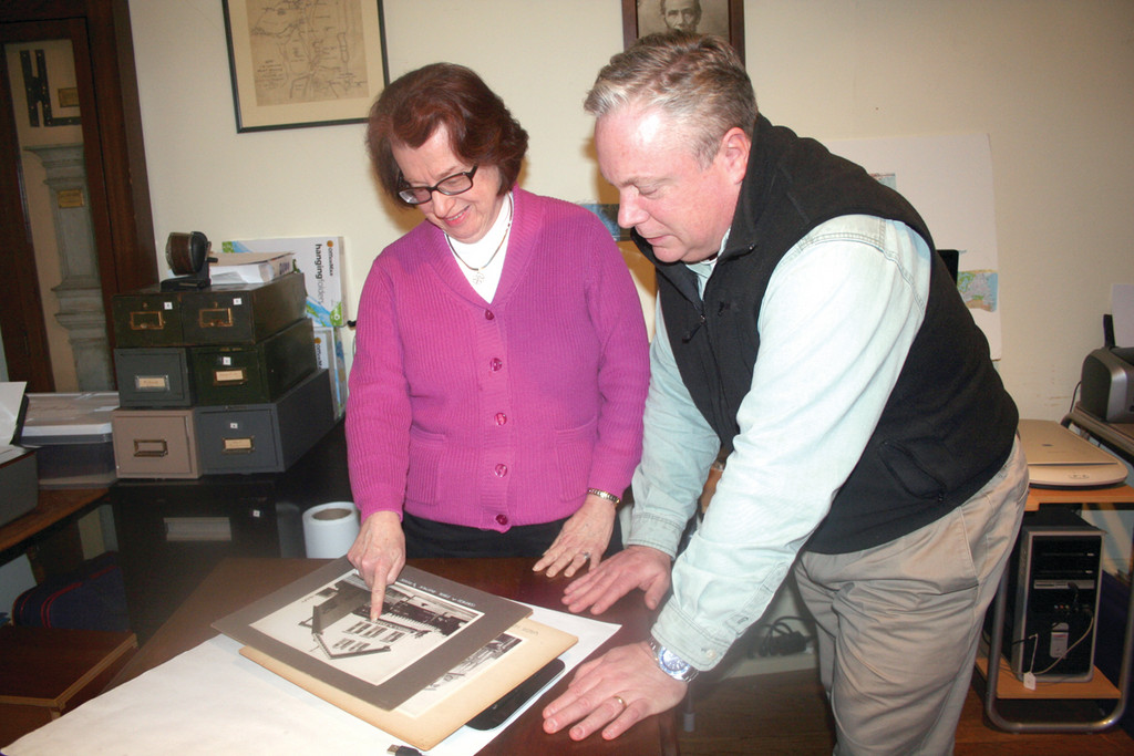 "IMAGES OF CRANSTON: Cranston Historical Society President Sandra Moyer and photo archivist Tom Worthington look over some of the historical images that could end up in a second installment of th ""Images in America: Cranston"" series."
