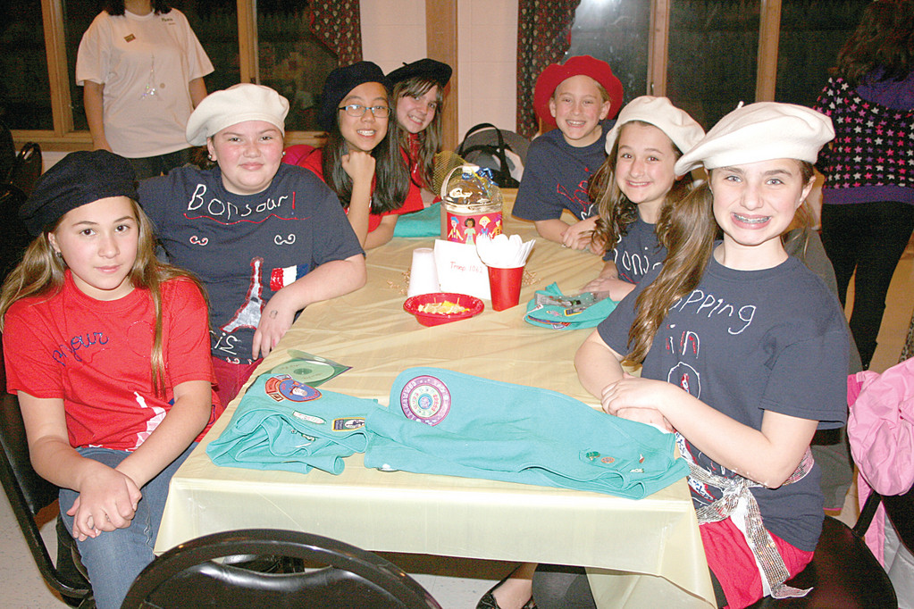 FRENCH THINKING CAPS: Junior Troop 1062 focused on the country of France, arriving in French berets for a fun-filled evening.