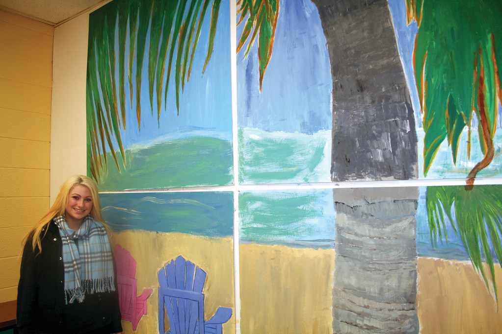 WORK OF ART: Natalia Perretta painted this seascape mural for the faculty dining room at the Cranston Area Career and Technical Center.