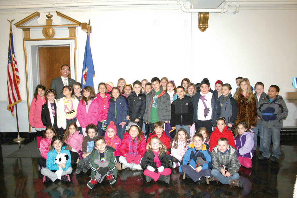 MANY FUTURE MAYORS: Mayor Allan Fung poses with the second graders in front of his office in City Hall, after visiting with them in the Council Chambers.