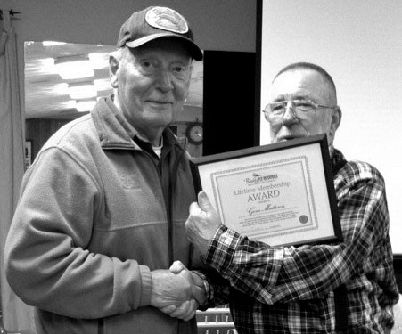Fly Rodders land awards: Gene Matterson (left) a club advisor and board member of the Rhody Fly Rodders for over 20 years is given a 'Lifetime Membership' award by Armand Corchaine, club president. Dave Loren, past president and board member and John Pope who serves as secretary/treasurer of the club also received a Lifetime Membership award. An 'Outstanding Service Award' was given to retiring vice president, Jim Burden.