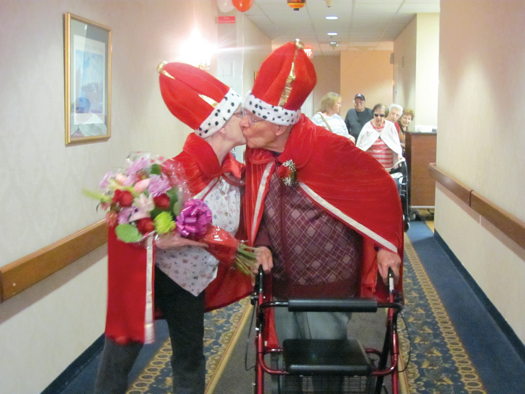 As Valentine's Queen Beverly Perry and King Dr. Domenic Vavala walk up the entranceway to The Bridge at Cherry Hill's main dining room, Perry suddenly stops and plants a kiss on her King's cheek.