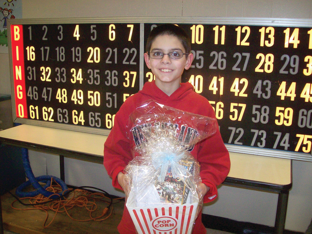 Fifth grader Thomes Sevigny shows off his Bingo prize