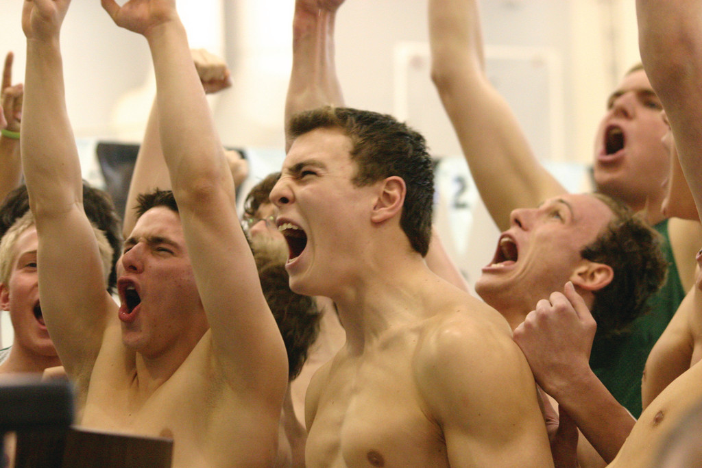 LOUD AND CLEAR: The Hendricken swim team reacts after the announcement of the final scores at Monday's state meet. The Hawks surged to another title.