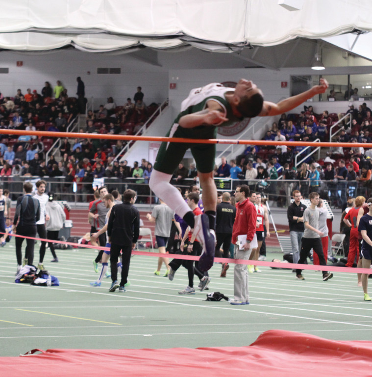 WAY UP HIGH: CCRI's Steven Vazquez competes in the high jump during Sunday's meet at Harvard.