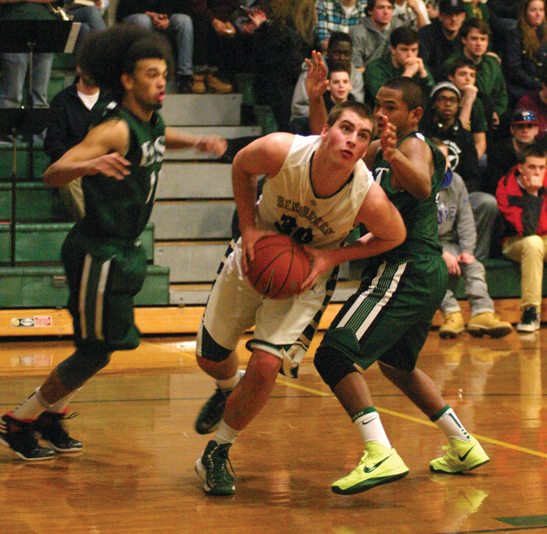 DRIVE: Hendricken's Ryan Hagerty makes a move to the basket during the Hawks' 48-23 win over Cranston East in Monday's preliminary round of the Division I playoffs