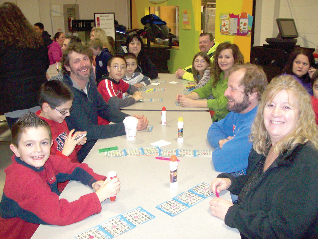 Barnes students and their families enjoy a game of bingo.