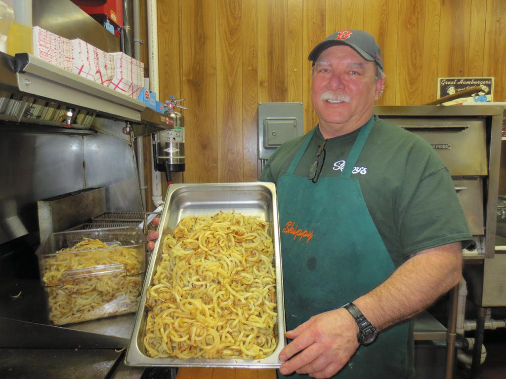 "Mark Hinsley, aka ""Skippy,""  showcases his wildly popular spiral-cut fries - made fresh every day at Skippy's."
