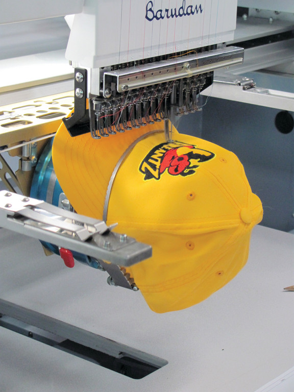 SPECIAL STICHES: This is just one of 40 state-of-the-art embroidery machines inside the Production Department at Squadlocker in Warwick. It's also an area that can mass produce a variety of outer wear and sports apparel from warm-up suits to custom designed uniforms.