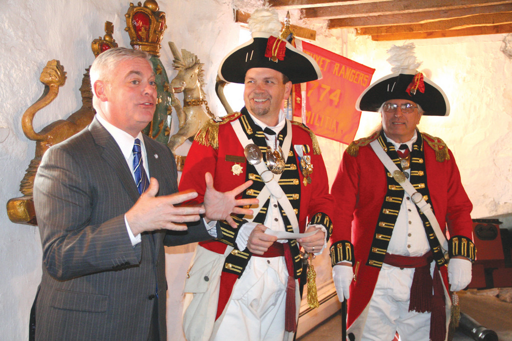 RECAPTURING THE PAST: Mayor Scott Avedisian expresses his unwavering support of Col. Ron Barnes, Major Ken Gilbert and the rest of the Pawtuxet Rangers in their efforts to bring a piece of their history home.