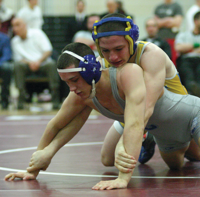 Vets' John Altieri wrestles on the way to his third consecutive state title.
