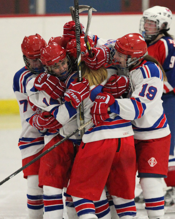 GOOD TIMES: The Warwick girls� hockey team celebrates after scoring the first of their four third-period goals en route to a victory over Mount St. Charles on Saturday