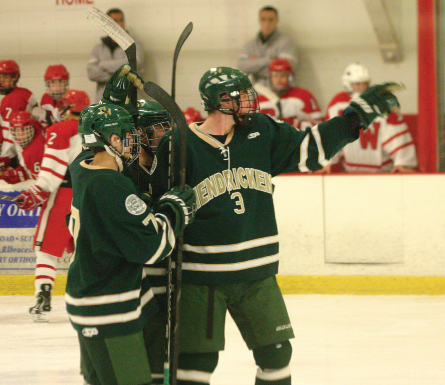 WAY TO GO: Matt Creamer and his Hendricken teammates celebrate after the first of his two third-period goals against Cranston West on Saturday.