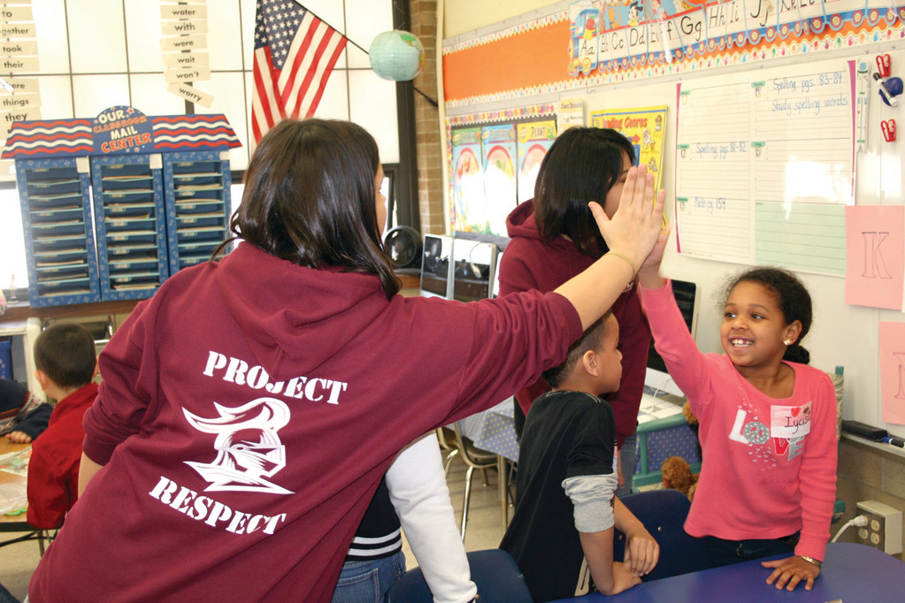 HIGH FIVE FOR KINDNESS: First grader Iycist Newman gets a high five from Marrisa Brynes for a great answer during their peer education lessons on kindness.