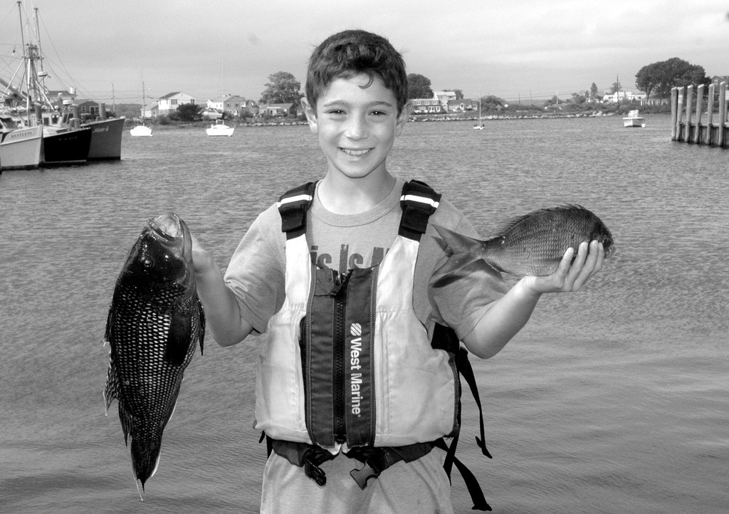 Joey Scrofani of Wakefield was recognized as junior angler of the year Saturday by the Rhode Island Saltwater Anglers Association (RISAA).  Joey shown with the award and jacket he received Saturday and with a black sea bass and scup he caught in a tournament last season.