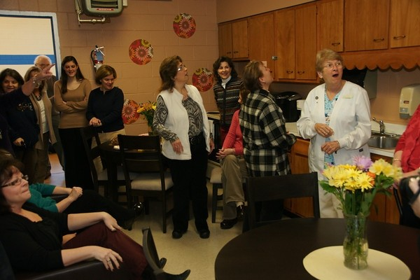 SURPRISE! During winter vacation, members of the St. Rose of Lima School's Home-School Association renovated the teachers' lounge. Last week, they unveiled the room to teachers.
