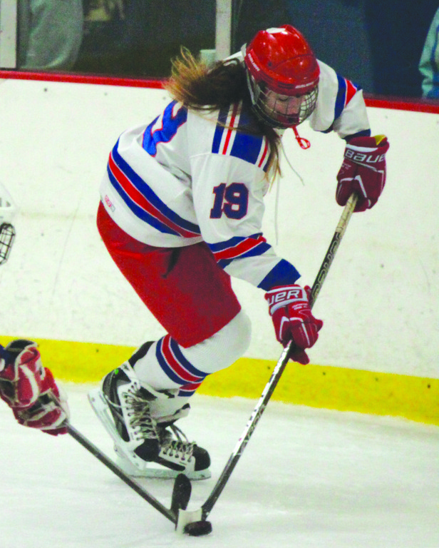 PUSHING UP: Warwick's Alyssa Mathews carries the puck out of the zone against Mount St. Charles.