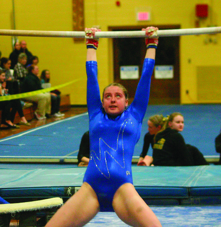 Vets' Kayleigh Desjarlais focuses on the bars.