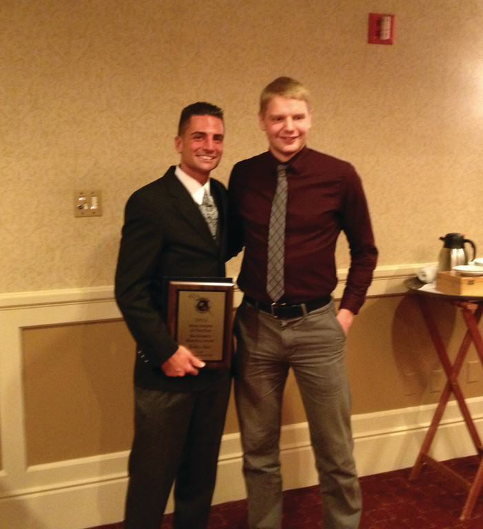 AWARDED: CCRI runner Bobby Allen (left) and assistant coach Hunter Stewart pose together after Allen was honored at the Words Unlimited dinner last weekend.